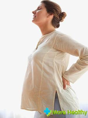 Тянущие боли в пояснице у беременных